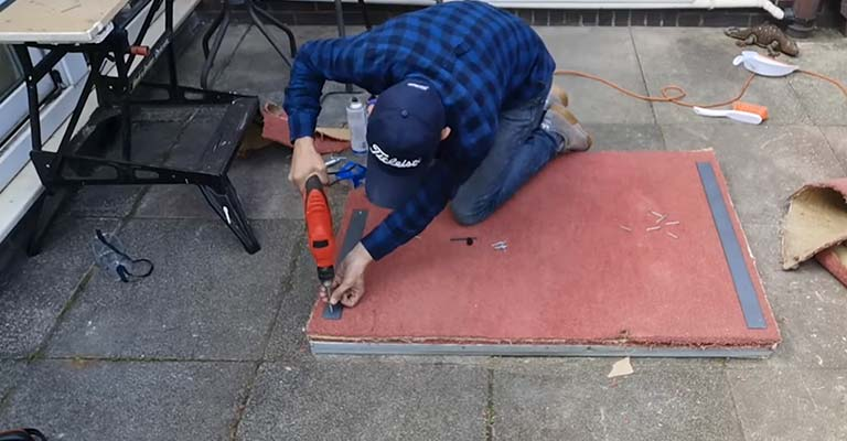 Drill a Hole Through the Plywood and Padding