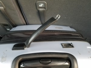 broken suitcase handle