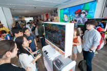 In this photo provided by Nintendo of America, fans gather at the Nintendo NY store in Rockefeller Plaza to celebrate International Sushi Day by eating sushi and playing the new Sushi Striker: The Way of Sushido game. An action-packed puzzle game thatÕs all about matching plates and eating sushi, Sushi Striker: The Way of Sushido is now available for the Nintendo Switch system and in 2D for the Nintendo 3DS family of systems. A free demo is also available in Nintendo eShop on Nintendo Switch Ð perfect for International Sushi Day on June 18!