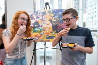 In this photo provided by Nintendo of America, Madison M., age 17, and Jackson M., age 13, celebrate International Sushi Day during a special event at the Nintendo NY store in Rockefeller Plaza by enjoying delicious sushi Ð just like the main character in the new Sushi Striker: The Way of Sushido game. An action-packed puzzle game thatÕs all about matching plates and eating sushi, Sushi Striker: The Way of Sushido is now available for the Nintendo Switch system and in 2D for the Nintendo 3DS family of systems. A free demo is also available in Nintendo eShop on Nintendo Switch Ð perfect for International Sushi Day on June 18!