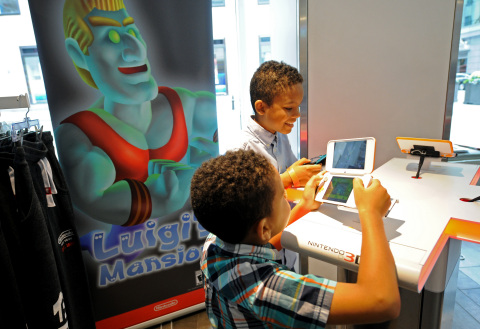 IMAGE DISTRIBUTED FOR NINTENDO OF AMERICA - Joshua A., 9 and Jacob A., 6, of Brooklyn, NY, help Luigi in his spooky adventure by playing Luigi's Mansion on the New Nintendo 2DS XL during a special event at the Nintendo NY store in Rockefeller Plaza on Sunday, Oct. 7, 2018, in New York. The classic game Luigi's Mansion will be available for the Nintendo 3DS family of systems on Oct. 12. (Diane Bondareff/AP Images for Nintendo of America)