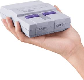 Hand Holding Super Nintendo Classic Edtion