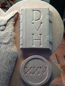 The carved book with initials DVH.