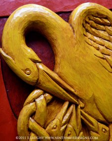 Detail of the painted finish on the pelican shield.