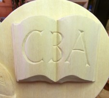 Detail of the open book with initials CBA.