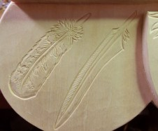 Detail of the owl and pelican feathers.