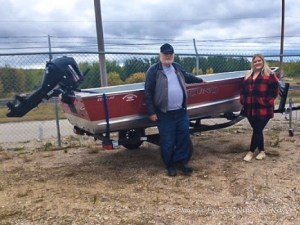 Gord Joyes of the Wounded Warriors Weekend Foundation presents the boat package donated by Lund to Jessica Hebb