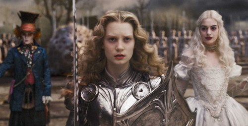 A Determined Alice going into battle against the Jabberwocky; The White Queen (Anne Hathaway) is behind
