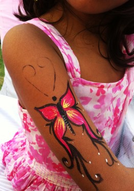 and a butterfly tattoo