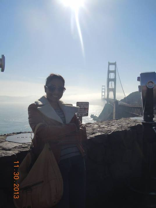 Posing at the end of the Golden Gate Bridge