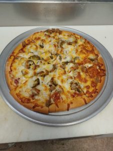 custom pizza with red sauce, cheese. sausage and jalapenos