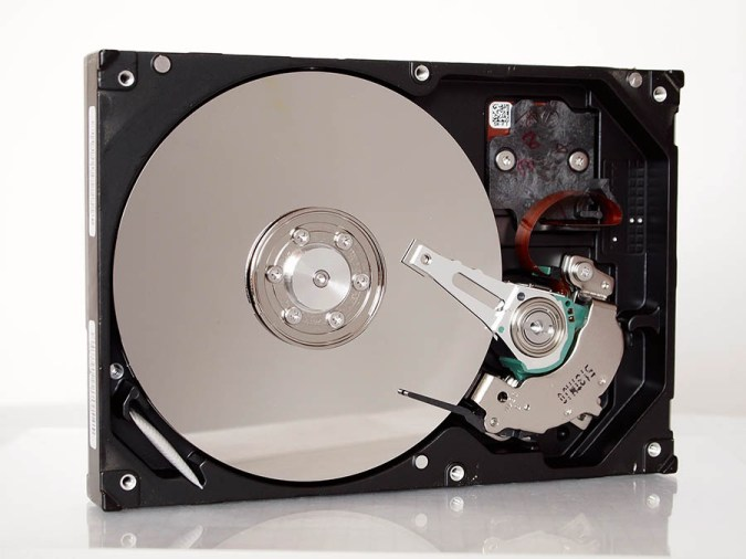 What is an SSD? Open hard drive with platters visible.