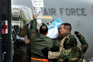 ABC News reporter Bob Woodruff is carried on a stretcher from a bus to a medical evacuation plane at Ramstein airbase, southern Germany, on Jan. 31, 2006. (Michael Probst/AP Photo)