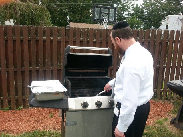Regency Park Administrator, Chaim Ribiat, lighting bbq grill for today's event!