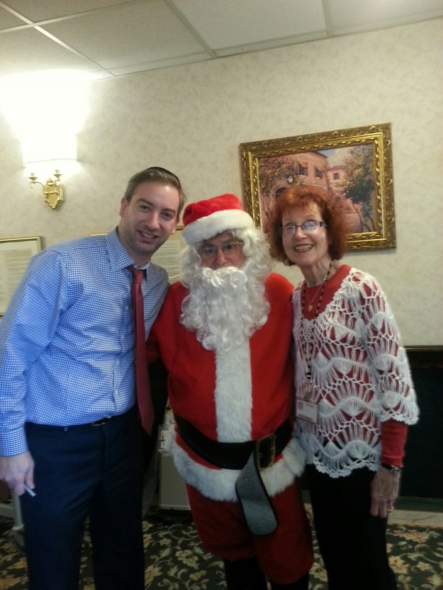 Pictured Left to Right: Regency Gardens Administrator, Mark Benedek, Santa Claus, Ruth Fengya, Recreation Department
