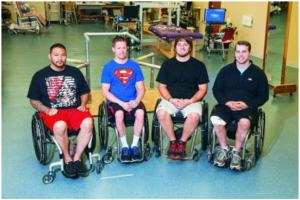 Left to right: Andrew Meas, Dustin Shillcox, Kent Stephenson and Rob Summers, the first four to undergo task-specific training with epidural stimulation at the Human Locomotion Research Center laboratory, Frazier Rehab Institute, as part of the University of Louisville's Kentucky Spinal Cord Injury Research Center, Louisville, Kentucky. Photo courtesy of the University of Louisville
