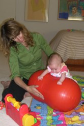 Doctor with physical therapy baby patient