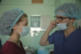 Two doctors discussing in operating room