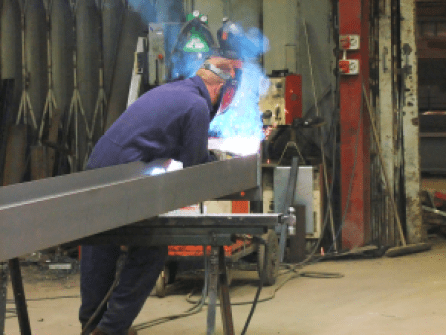 One of our welders working on a rafter