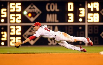 Phillies Chase Utley dives but cannot get to Chris Duncan's single in the 8th inning of July 8th game at Philadelphia.
