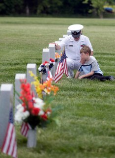 Chief James Puglia, US Naval reserve, and his son Rocco,7 visit the gravesite their Uncle Carmen Puglia a Vietnam veteran who died last year. 5/24/09.
