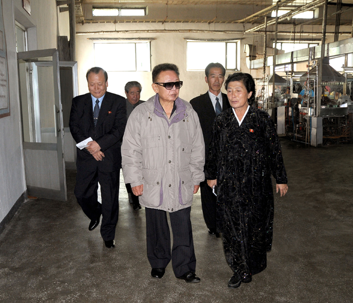 Kim Jong-il tours Huichon Silk Mill. (Photo: KCNA)