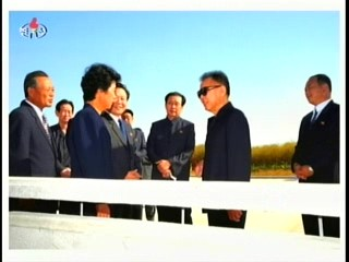 Kim Jong-il talks (or guides) the Party Secretary while Jang Song-thaek (center) looks on (Photo: Korea Central TV)