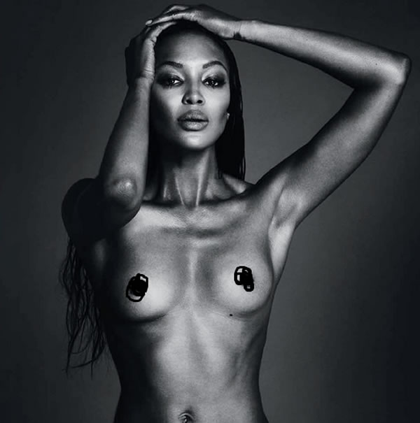 Naomi Campbell shows breast