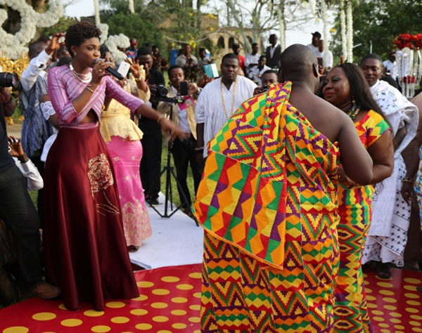 Becca singing for Gifty Anti and her husband at wedding