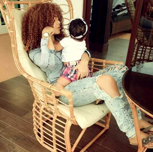 Nadia Buari and one of her twins