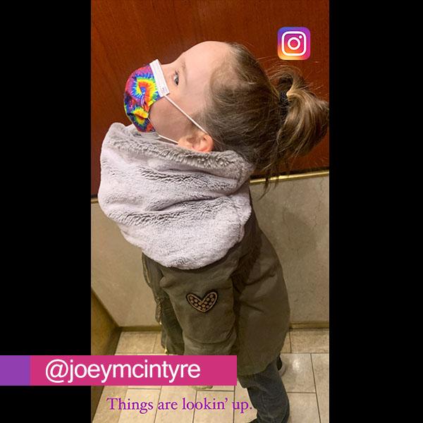 Kira McIntyre looking up in an elevator