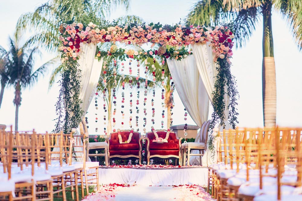 Red Floral Arch at Indian Wedding Ceremony