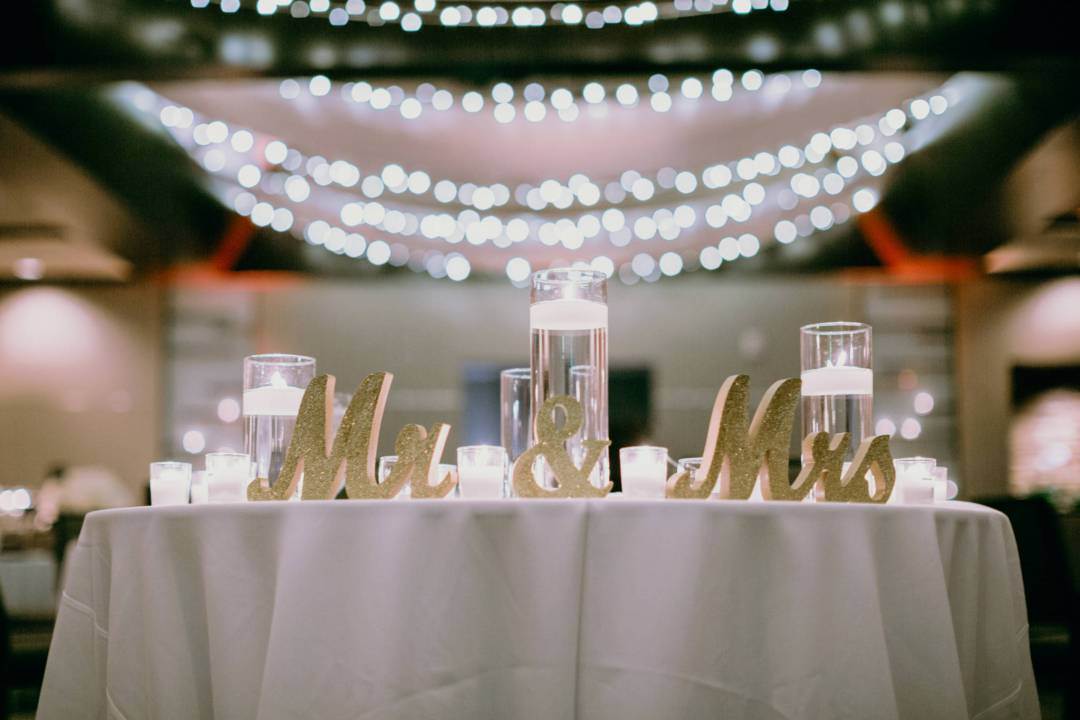 sweetheart table with signs