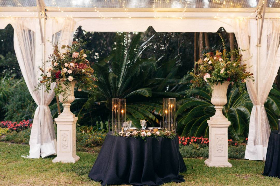 sweetheart table with high floral accents