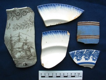 Ceramics from the cellars include a transfer-printed ware (left), shell-edged pearlware plates (centre), an annular-ware mug (top right) and a stamped pearlware plate