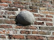 Times were tough- cannonball stuck in the city wall (Hasselt)