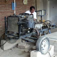 Car engine used to power a pump to supply water to a community-based water co-op in Cochabamba.
