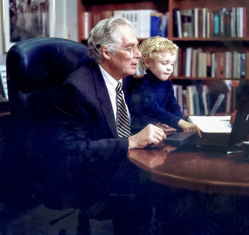 Dr. Donald Lindberg with grandson, Martin, in his NLM office.