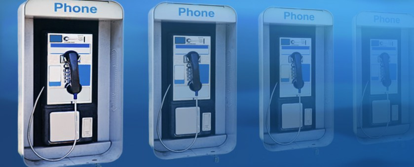 Four pay phones that gradually fade into the background.