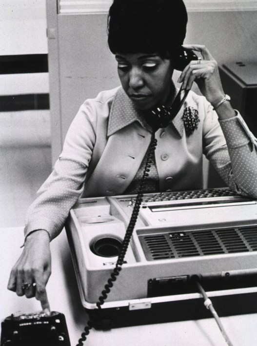 A library user dials in to MEDLINE using a rotary phone, circa 1970.