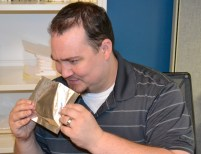 A man inspects one of the open Marval Seal pouches.