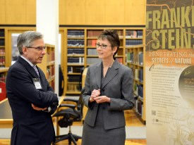 Chariman Adams and Patricia Tuohy in the Reading Room discussing the Frankenstein exhibition.