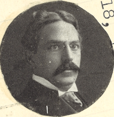 A halftone newspaper photo of a man in a suit.