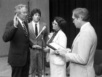 Dr. Donald Lindberg takes the oath of office