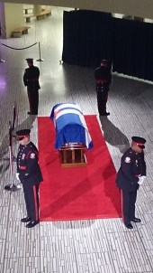 An honour guard of Toronto police officers guard Rob Ford's casket on March 29, 2016. Photo credit: Peter Paul