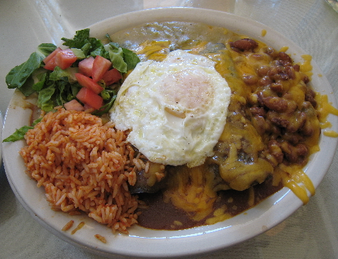 A New Mexican Combination Plate Served Christmas Style with a Fried Egg