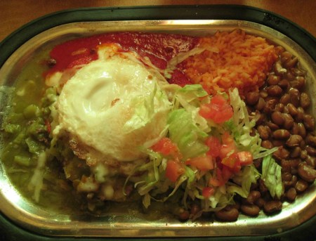 Ground beef enchilada with a fried egg on top