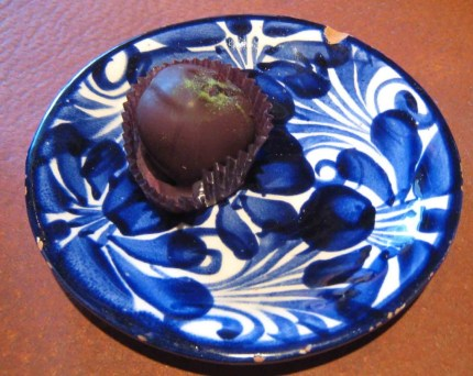 A truffle of Chaya, Mesquite, Prickly Pear Fruit Nectar and Oaxacan Chile Pasilla