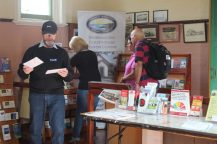 Volunteers Ron and Lyn helping visitors