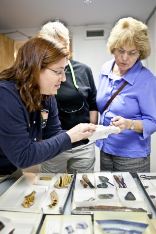NMSC staff sharing artifacts with visitors at public program. (Photo by Norm Eggert for NMSC)